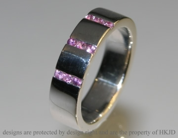 9ct white gold eternity ring with 9 channel set pink sapphires