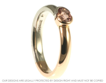 9ct white and rose gold engagement ring with a 0.46ct pink sapphire