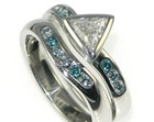 a trilliant cut, white diamond engagement ring with heat treated sky blue shoulder diamonds