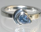 white gold art deco flower bud ring with pear shaped sapphire