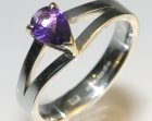 a 9ct white and yellow gold pear shape amethyst engagement ring