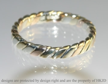 A 9ct three colour gold Celtic twist wedding ring