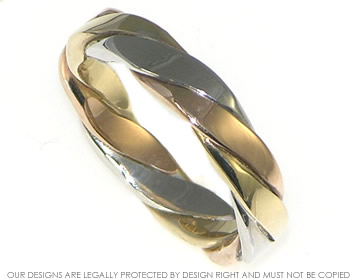 A 9ct three colour gold wedding ring inspired by celtic twists