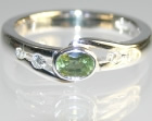 9ct white gold engagement ring with 0.47ct oval cut green sapphire and diamonds