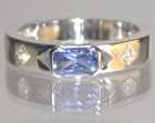 a scissor cut 0.49ct blue sapphire engagement ring with split shoulders and side diamonds totalling 0.10ct