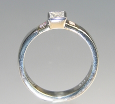 9ct yellow and white gold engagement ring with 0.22cts central diamond