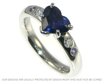 platinum ring with rare colour change heart shaped sapphire and diamonds
