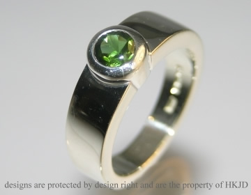 chunky silver ring with deep green tourmaline
