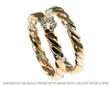 twist style celtic diamond engagement ring with matching celtic wedding band