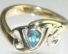 9ct white and yellow gold dress ring with a pear shaped 0.23ct topaz
