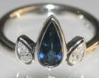 platinum tulip inspired ring with 1ct deep blue pear shape sapphire and h si diamonds