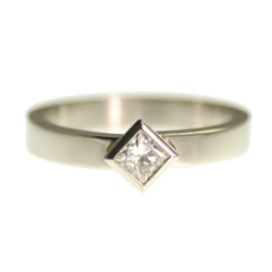 platinum solitaire engagement ring with a 0.25ct princess cut diamond