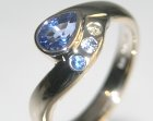 an 18ct white goldsapphire and diamond embrace inspired engagement ring