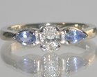 platinum diamond and sapphire ski and colour inspired engagement ring