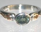 bespoke platinum and 18ct yellow gold engagement ring sapphire and heat-treated diamonds