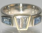 18ct yellow and white gold ring with two tapered baguette cut diamond totalling 0.72ct and two sapphire totalling 1.14ctart deco inspired