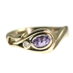 18ct white gold flower inspired diamond and lilac sapphire ring