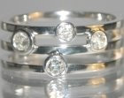 18ct white gold combined wedding and engagement ring with customers own diamonds totaling0.47ct