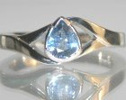 platinum engagement ring with a pear shaped sapphire