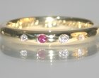 bespoke 18ct yellow gold eternity ring with ruby and diamonds