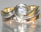 18ct yellow and white gold twist style engagement ring with lilac sapphire and diamond