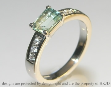emerald cut green beryl and diamond 18ct white gold engagement ring