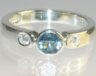 9ct white gold engagement ring with abrilliant aquamarine and side brilliant cut 2.5mm diamonds totalling 0.14ct