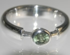 18ct white gold engagement ring with a 0.36ct green sapphire
