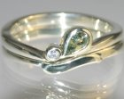 green sapphire and diamond butterfly inspired white gold engagement ring