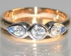 18ct rose and white gold dress ring using customers own diamonds and two 1.5mm sapphire
