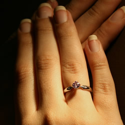 a platinum pink sapphire and diamond flower inspired engagement ring