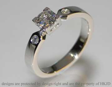 platinum three diamond engagement ring with 0.43cts centrail diamond