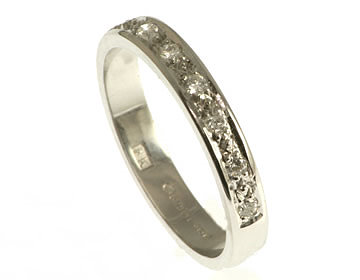 18ct white gold diamond eternity or wedding ring with pave settings