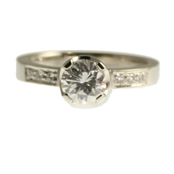 platinum 1ct diamond engagement ring with pave shoulder diamonds