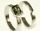 platinum engagement ring with green sapphire and diamonds