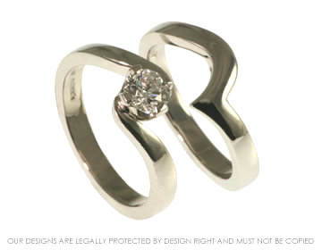 platinum diamond solitaire swirl engagement ring with fitted wedding ring