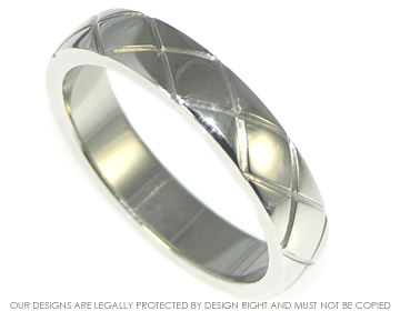 platinum wedding band 4mm wide with engraved stylised kiss design