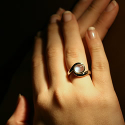 platinum engagement ring with a rare blue sheen moonstone