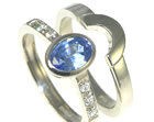oval sapphire and diamond engagement ring with a fitted wedding ring