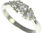 platinum cluster engagement ring with 0.22ct central diamond