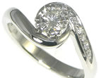 platinum swirl engagement ring with a central 0.51ct h si diamond