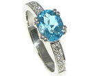 sea and sky inspired platinum and topaz engagement ring
