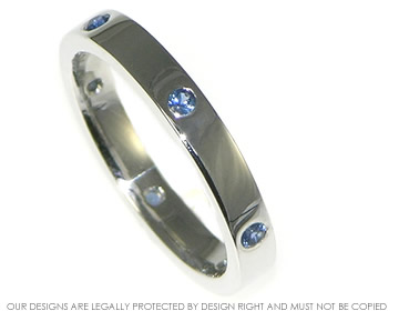 classic 9ct white gold eternity ring with blue sapphires equally spaced around the band