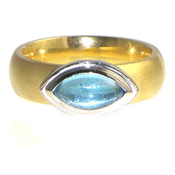 an 18ct goldcabochon cut topaz engagement ring with an interesting setting