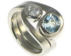 bespoke pair of palladium twist rings with aquamarine and diamond