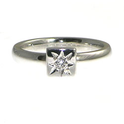 white gold diamond solitaire with star set brilliant cut diamond