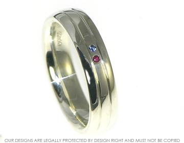 9ct white gold 'parallel paths' wedding ring with a ruby and sapphire