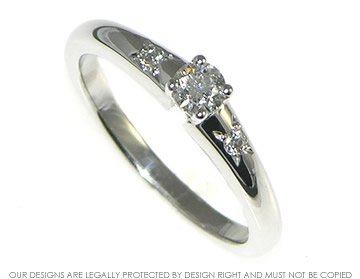 18ct white gold engagement ring with brilliant cut central and shoulder diamonds