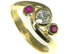 bespoke 18ct yellow gold eternity ring with central 4.8/4.9mm 0.44ct h si diamond and two mm brilliant cut rubies totaling 0.24cts