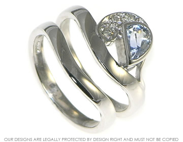 crest of a wave inspired sapphire and diamond engagement and wedding ring set